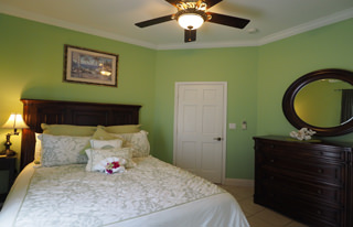 Green Bedroom, comfortable queen bed with ceiling fan and air conditioning