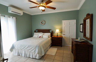 Turquoise Bedroom, comfortable queen bed with ceiling fan and air conditioning